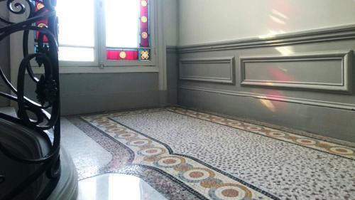 Rénovation mosaïque de marbre à Paris